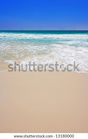 A sunny, tropical beach - useful as background - stock photo