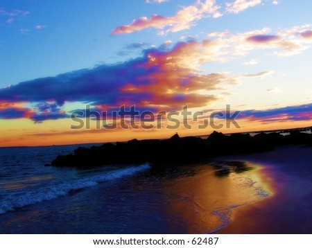 a sunset background in ny on a beach - stock photo