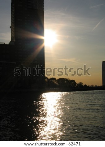 a sunset in ny near the financial district - stock photo