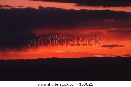 A sunset in the Badlands. - stock photo
