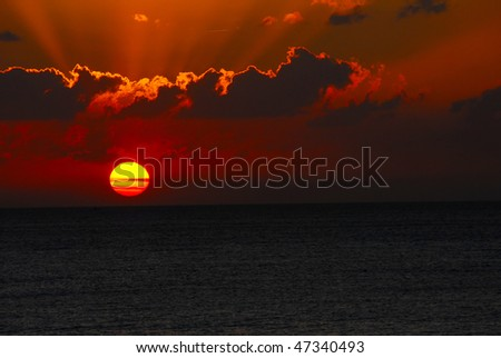 A sunset over the ocean - stock photo
