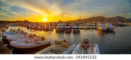 A sunset over the port in Villiasimius, Sardinia - stock photo