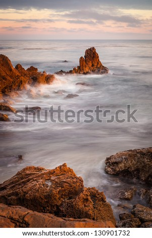 A sunset shot of Big Corona Beach, looking out to the Pacific Ocean. - stock photo