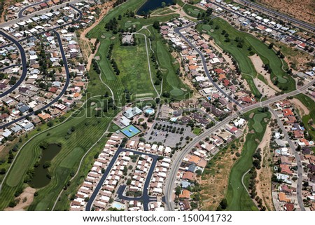 A super green golf course viewed from above in southeast Arizona - stock photo