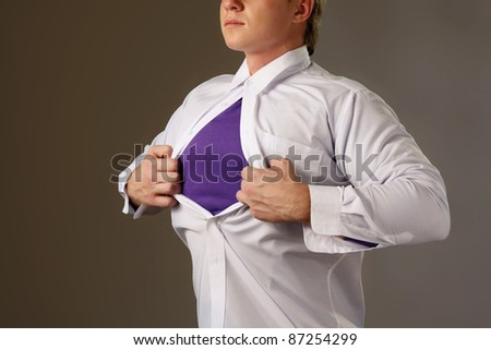 A superman, isolated on grey, side-view - stock photo