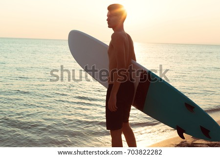 A surfer at sunset.