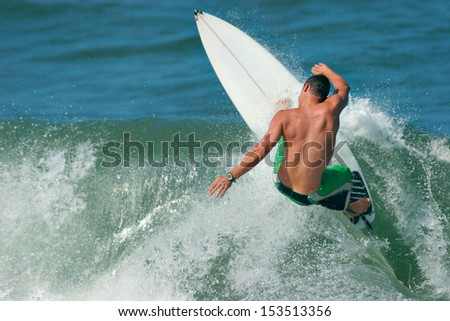 A surfer carves a radical off-the-lip. - stock photo