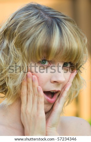 A surprised girl - stock photo