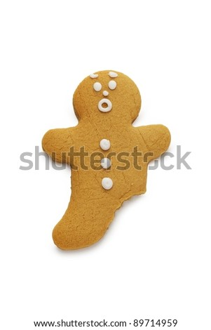 A surprised looking gingerbread man with a leg missing - stock photo