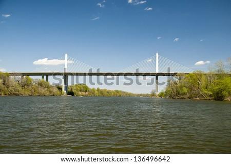 A Suspension Bridge over a River - stock photo