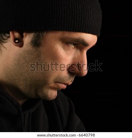 A suspicious male portrait - burglar, prowler, thief. - stock photo