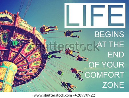 A swinging fair ride with carefree riders spinning around at dusk toned with a retro vintage filter app or action effect with the text: life begins at the end of your comfort zone  - stock photo