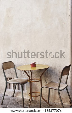 A Table And Chairs On the stereet - stock photo