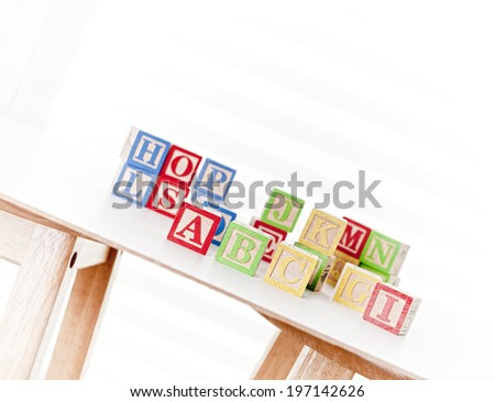 A table filled with blocks that have letters on them. - stock photo