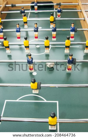 a table football match between the blue and yellow teams