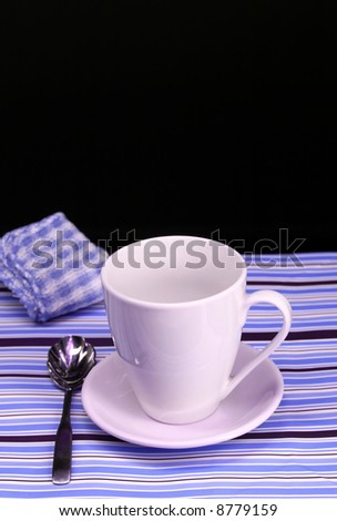 A table set for a coffee break in blue - stock photo