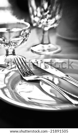 A table setting in black and white with selective focus