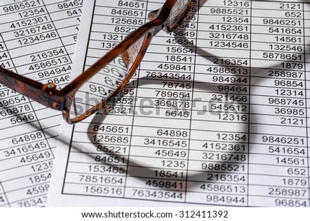 a table with the figures of revenue and expenditure. photo icon for kosetn, profit, controlling - stock photo