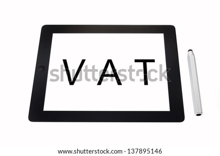 A tablet displays the word VAT symbolizing - stock photo