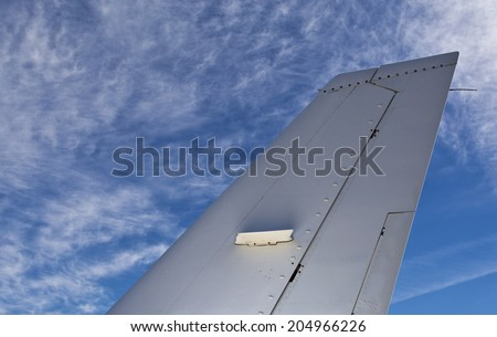 A tailplane, also known as horizontal stabilizer, is a small lifting surface located on the tail  behind the main lifting surfaces of a fixed-wing aircraft. - stock photo