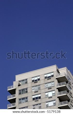 a tall building with a clear bright blue sky - stock photo