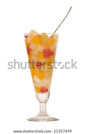 A tall glass of healthy fruit for desert.