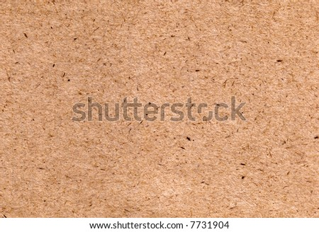 A tan sheet of textured paper, suitable as a background texture. - stock photo