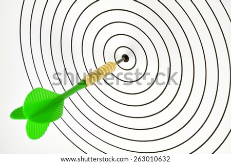 A target was hit by a dart in the center. - stock photo
