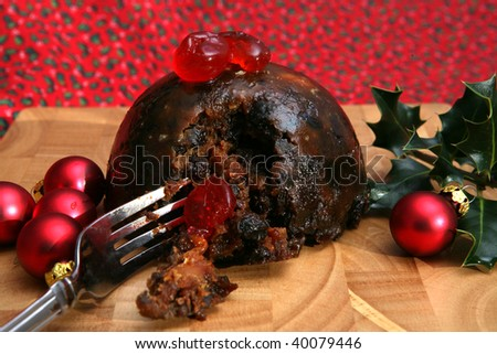 A tasty Christmas Pudding with Cherries and Baubles - stock photo