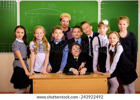 A teacher and her students at school. Education. - stock photo