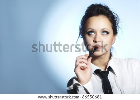 A teacher with a pen in his mouth - stock photo
