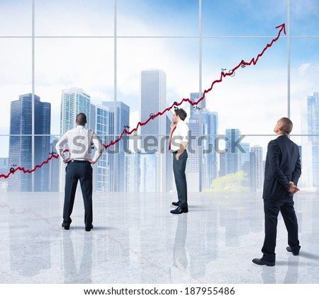 A team looks successful statistics in a modern office - stock photo