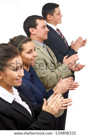 A team of business people clapping in line - stock photo
