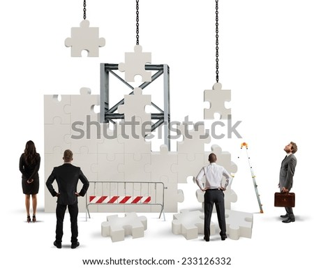 A team of businesspeople builds a new company - stock photo