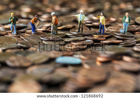 A team of construction workers working hard to recover the economy. - stock photo