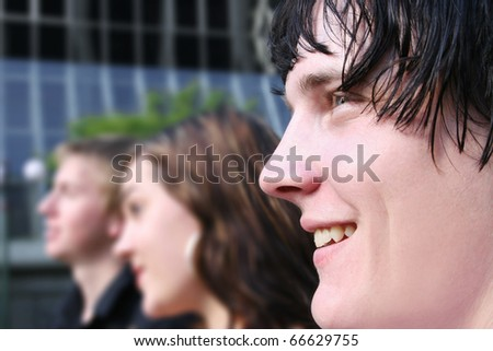 A Team Of Happy Professional Business People Facing Forward - stock photo