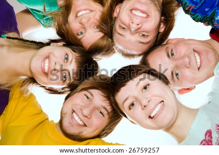 A team of happy young people. From below - stock photo