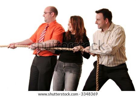 A team of three in a tug of war pulling in the same direction isolated on a white background - stock photo