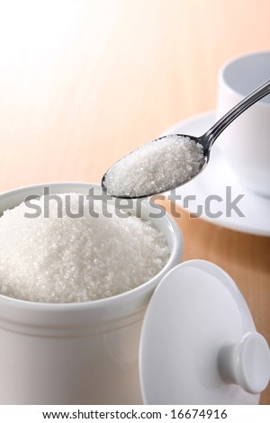 A teaspoonful of sugar for your coffee or tea - stock photo