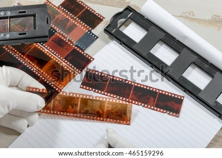a technician scan a negative film