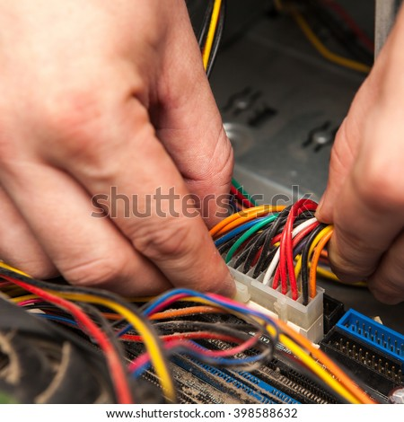 A technician stuck in the motherboard power cable.