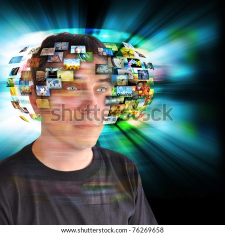 A technology man has images around his head with an abstract glow. Use it for a communication or tv concept. - stock photo