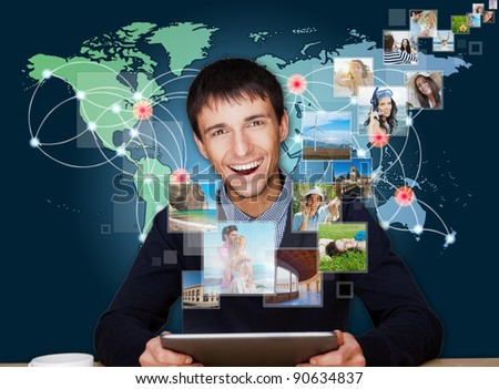 A technology man has images flying away from his modern tablet computer, He is at home. Designed poster for a communication, social media sharing or tv concept.