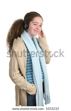 A teen girl enjoying listening to music through headphones.  Isolated.