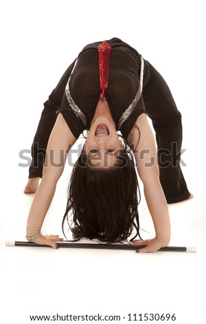 a teen girl in her jazzy outfit doing a back bend with a big smile on her face - stock photo