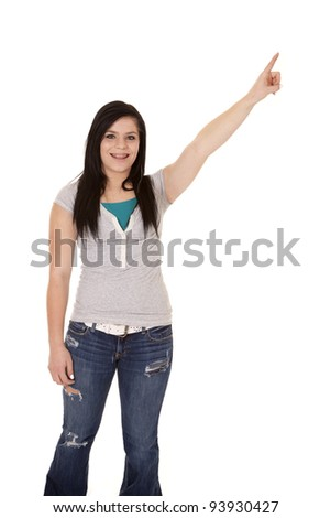 a teen girl with a big smile on her face pointing up to the sky.