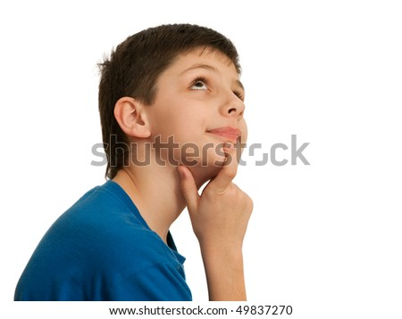 A teen is thinking looking upstairs; isolated on the white background