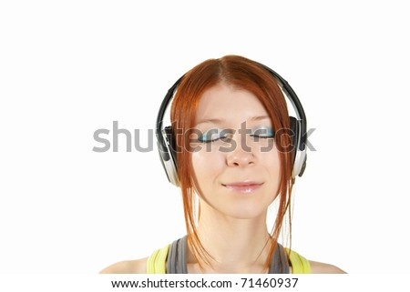 a teenage girl in a red shirt listening music with headphones
