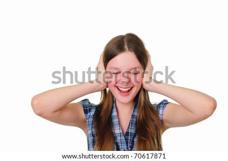 a teenage girl in studio holding her hand near the ears - stock photo