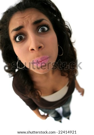 A teenage girl with a funny expression. The picture was taken with fisheye lens - stock photo